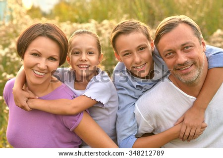 happy family at summer green blooming field #348212789