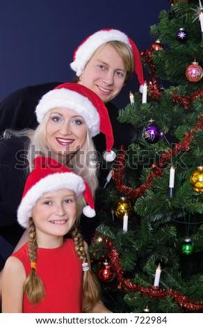 happy family at the christmas tree