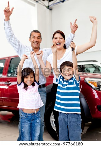 Happy family at the dealership buying a new car