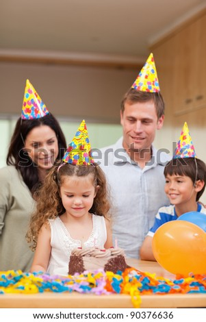 Happy family celebrating daughters birthday together