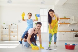 Happy family cleans the room in the house.