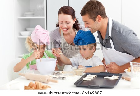 Happy family cooking a cream together in the kitchen while little boy adding sugar in the preparation