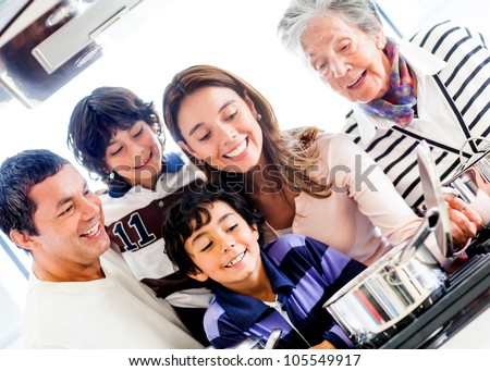 Happy family cooking together at home and smiling