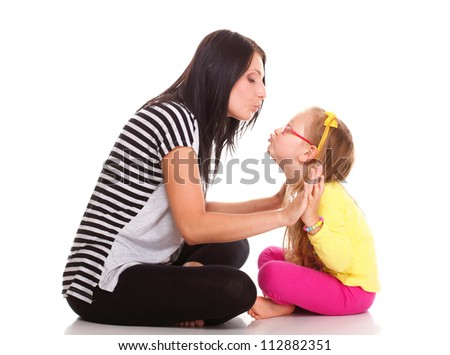 happy family, cute three year old litle baby laughing toddler girl playing with mom doing a fun