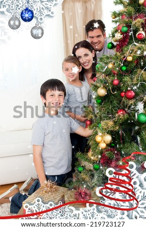 Happy family decorating a Christmas tree with boubles and presents against twinkling stars