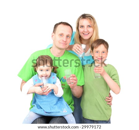 Happy family drinks pure water