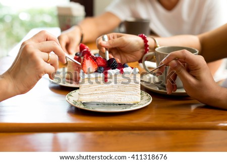 Happy family enjoy eating cake in the restaurant