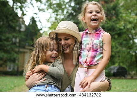 Photo of Happy family enjoy ,mother hugging hers daughters.