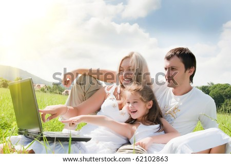 Happy family enjoy outdoors - stock photo