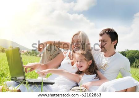 Happy family enjoy outdoors - stock photo