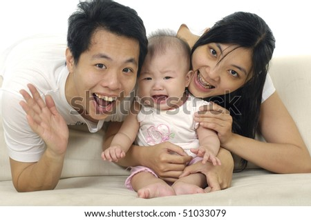 Happy Family enjoying baby together isolated