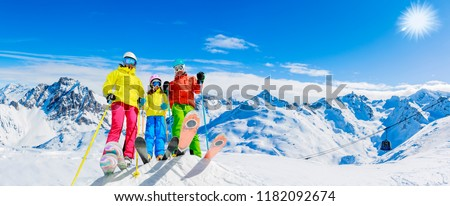 Happy family enjoying winter vacations in mountains. Ski, Sun, Snow and fun.