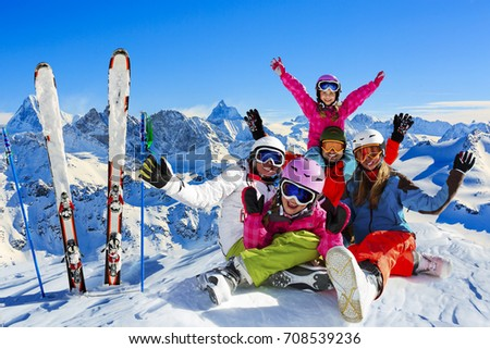 Happy family enjoying winter vacations in mountains . Ski, Sun, Snow and fun. Composite photo, photo manipulation,  only 4 model releases needed. - Shutterstock ID 708539236