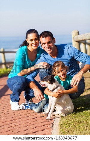 happy family family at the beach with pet dog