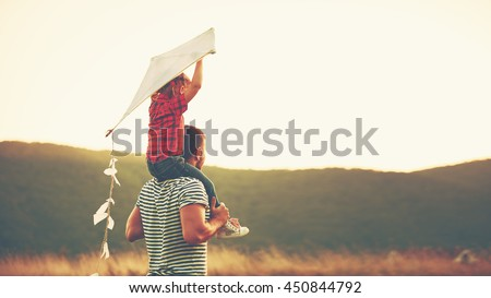 happy family father and child on meadow with a kite in the summer on the nature #450844792