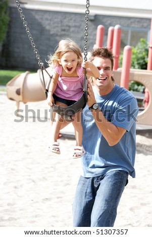 Happy family. Father and daughter in the park