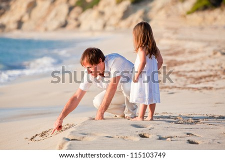 happy family father and daughter on beach having fun summer vacation