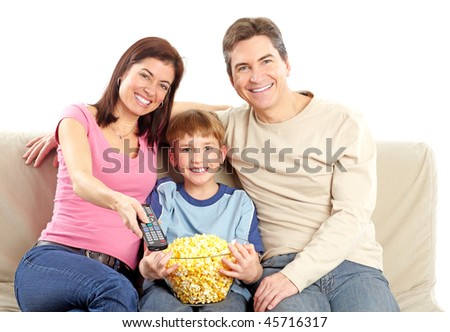 Happy family. Father, mother and boy watching TV. Over white background