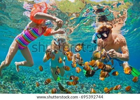 Happy family - father, mother, child in snorkeling mask dive underwater with tropical fishes in coral reef sea pool. Travel lifestyle, water sport adventure, swimming on summer beach holiday with kids #695392744
