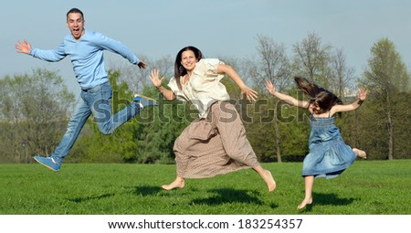 Happy  family. Games in nature