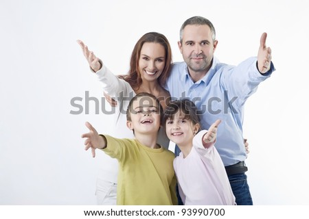 Happy family gesturing - Studio shot
