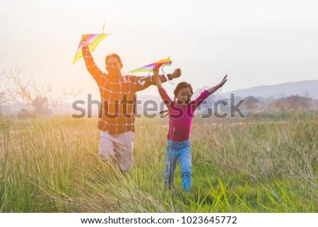 happy family .Girl runs kite in summer #1023645772