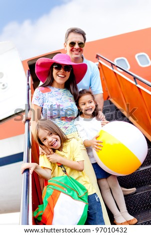 Happy family going on holidays by airplane