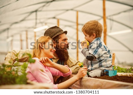 happy family. happy family in greenhouse. happy family day. happy family with little son in orangery #1380704111