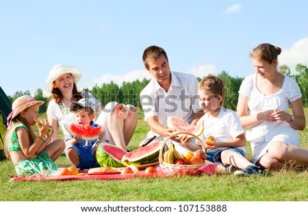 happy family have a picnic outdoor - stock photo