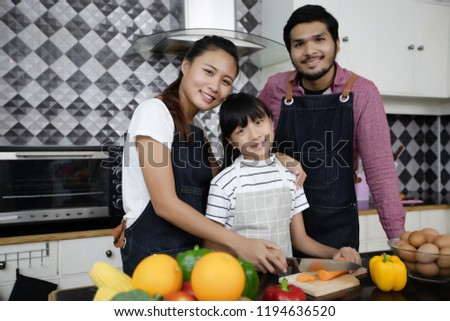 Happy asian young Family enjoy their lunch Images and Stock