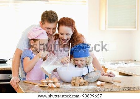 Happy family having a great time baking together