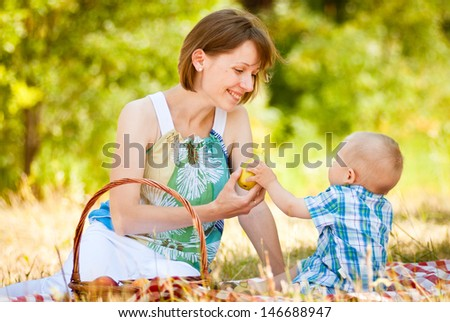 Happy Family Having a Picnic In Summer Park