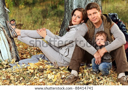 Happy family having a rest outdoor.