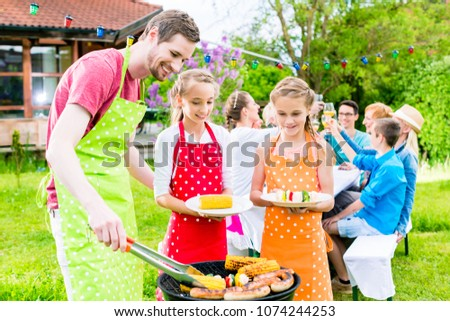 Happy family having barbeque at garden party #1074244253