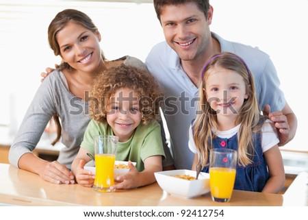 Happy family having breakfast in their kitchen