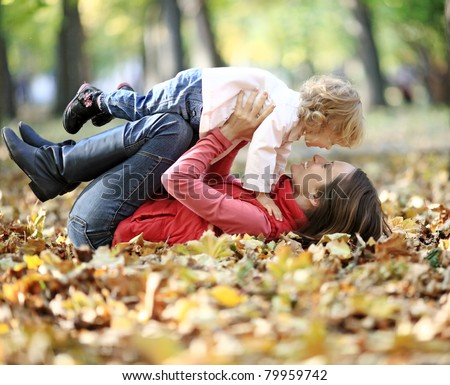 Happy family having fun in autumn park