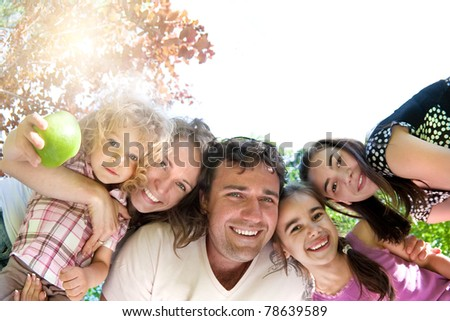 Happy family having fun in summer park