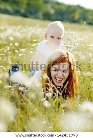 happy family having fun in the field