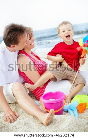 Happy family having fun on the beach.