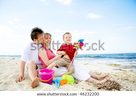 Happy family having fun on the beach.