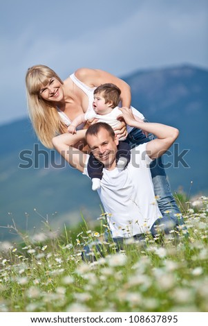 happy family having fun outdoors - stock photo