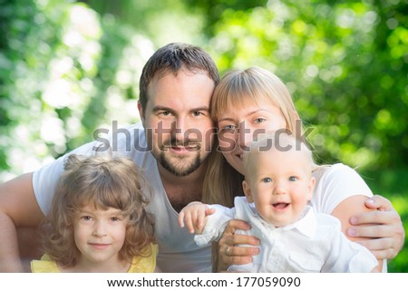Happy family having fun outdoors against spring green background #177059090