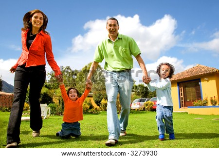 happy family having fun outdoors at home on a sunny day - stock photo