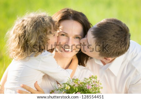 Happy family having fun outdoors in spring green field