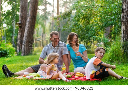 happy family having fun outdoors on a sunny day
