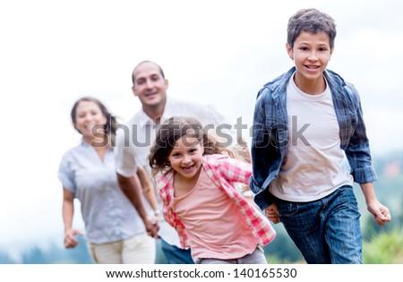 Happy family having fun racing at the park