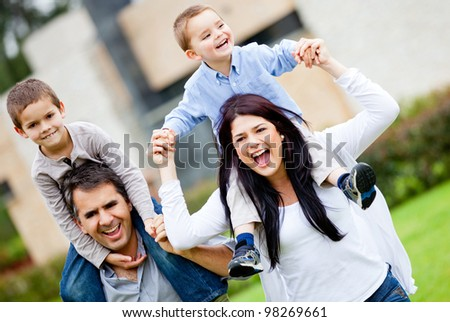 Happy family having fun running outdoors and smiling