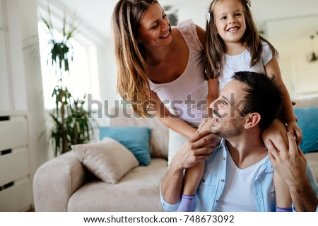 Happy family having fun times at home #748673092