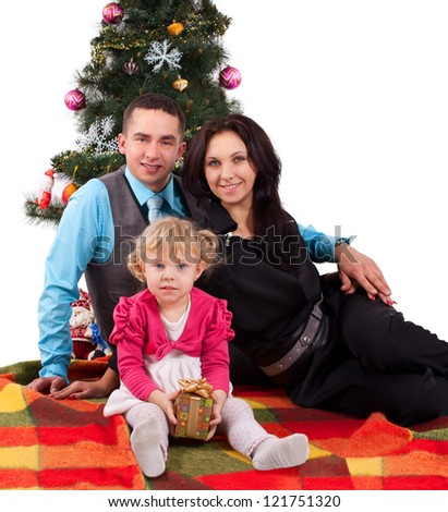Happy family having fun with Christmas presents at home