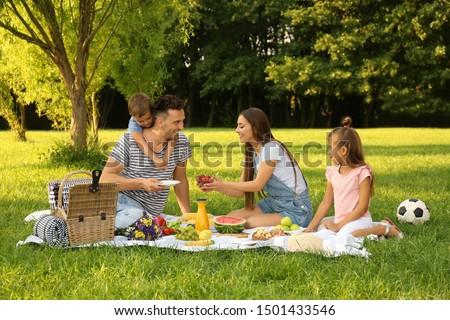 Happy family having picnic in park on sunny summer day Сток-фото ©